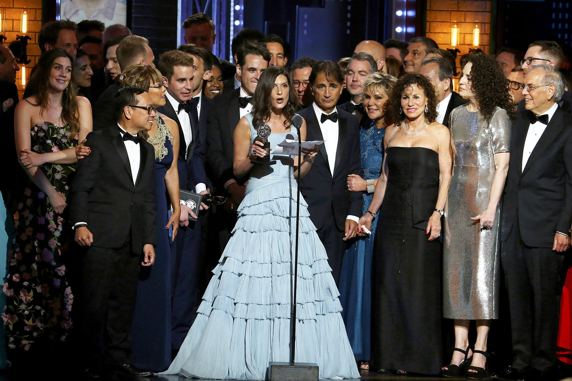 "Wendy Orshan and the cast and crew of ""Dear Evan Hansen"" accept the award for best musical at the 71st annual Tony Awards on Sunday, June 11, 2017, in New York. (Photo by Michael Zorn/Invision/AP)"
