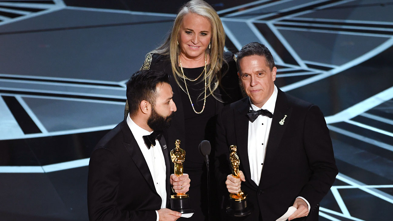 HOLLYWOOD, CA - MARCH 04: (L-R) Filmmakers Adrian Molina, Darla K. Anderson and Lee Unkrich accept Best Animated Feature Film for 'Coco' onstage during the 90th Annual Academy Awards at the Dolby Theatre at Hollywood & Highland Center on March 4, 2018 in Hollywood, California. (Photo by Kevin Winter/Getty Images)